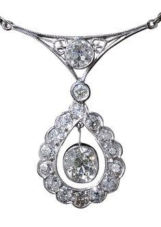 Art Deco Diamond Platinum Pendant Necklace.  This stunning and sparkling original Art Deco necklace, handcrafted in platinum, circa 1920s-1930s, features a beautiful bezel-set 1.10 carat European-cut diamond swinging freely inside a scalloped, diamond-set, teardrop-shape surround.