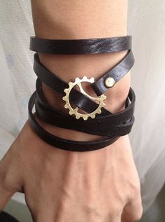 Steampunk Bracelet -5 Circles Black Leather Wrap Bracelet Adjustable With Gears Galore Steampunk Bracelet. $9.50, via Etsy. || Steampunk