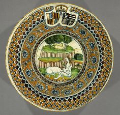 Dish with an allegory of Chastity and the arms of Matthias Corvinus and Beatrice of Aragon, 1476–ca. 1490  Probably Pesaro  Tin-glazed earthenware (maiolica)