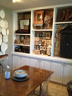 Here is our dining room.  Our dining and living rooms occupy one large room.  These built in shelves are a life saver.  When it comes to organizing collections they are the best!