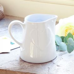 Inspired by relaxed country living this simple yet attractive jug is the perfect addition to the breakfast table. Finished in off white with raised heart detailing to both sides. Use at the breakfast table to serve juices at the dinner table to serve sauces or as a decorative way of displaying cut fresh flowers!