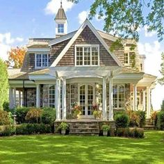 Stunning and beautiful traditional 2 story stone house has that classical look featuring an extended front porch with white columns, pitched roof, and gable windows. Stone Front House, House Front, Front Porch, Building A Porch, Building A House, Style At Home, Home Design, Design Ideas, Patio Interior