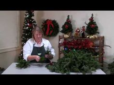 DIY Evergreen Christmas wreath making tutorial.  She makes it look so easy, and that sucker is gorgeous when she's done! Much better than the fake ones.