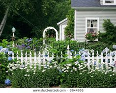 Superieur Beautiful Garden Setting With Flowers And White Picket Fence