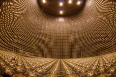 The Super Kamiokande neutrino detector buried underground in Japan. Usually filled with tonnes of pure water, the observatory detects neutrinos by watching for interactions with the subatomic particles in the water Paul Dirac, Ibaraki, Gifu, Einstein, Andreas Gursky, Nobel Prize In Physics, Physics Experiments, Physics Topics, Big Bang