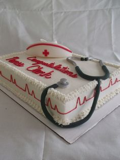 Nursing Graduation Cake Chocolate cake covered in buttercream icing. The nursing cap and the stethoscope are made out of gumpaste Nursing Graduation Cakes, Graduation Food, Graduation Cupcakes, College Graduation, Doctor Cake, Nurse Party, Retirement Cakes, Retirement Celebration, Buttercream Icing