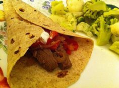 Slow Cooker Beef Fajitas      1 3/4 -2lb. Flank steak  1 large onion- cut into thin slices  1 C salsa  4 Tablespoons fresh cilantro  4 Tablespoons fresh lime juice  3-4 cloves of garlic-crushed  2 Tablespoons Chili Powder  1/2 teaspoon Cumin  2 red bell peppers cut into strips  Salt  Flour totrillas-warmed    1. Cut flank steak in 1/2 lengthwise then crosswise into thin strips. Place in crockpot.    2. Combine onion, salsa, cilantro, lime juice, garlic, chili powder, cumin, & salt over meat. Coo