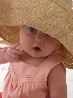 * Awwww, can you get any cuter in a big floppy hat? (sp)