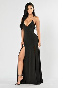 - Available in Burgundy and Black - V Neckline Criss Cross Back - Maxi Length - Front Slits - Open Back - 96% Polyester, 4% Spandex