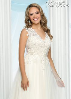 DaVinci Bridal Style # 50420 This tulle gown has a v-neckline adorned with lace extending into a high sheer back with intricate beading.  Buttons drape down the sheer back and the full tulle skirt extends into a chapel length train.