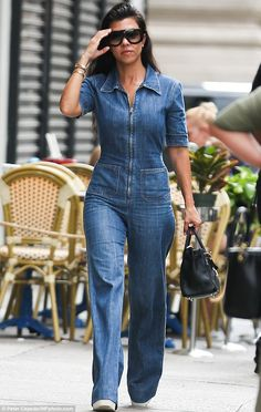 Back from holiday: Kourtney Kardashian was spotted stateside after enjoying a European holiday as she stepped out in a denim jumpsuit in New York City on Friday
