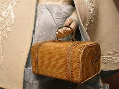 Okay, it is doll size and not quite impression bound... but it is sooo cute.     Antique Doll Valise French Fashion Size Fine Straw Covered Board Brass Handle