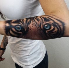 Blue eyed tiger tattoo