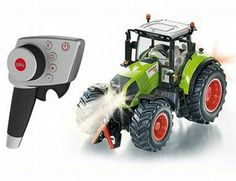 The Claas Axion 850 RC Tractor from the Siku RC Tractor range - Discounts on all Siku Diecast Models at Wonderland Models. Siku Farmer 1 32, Siku Control 32, Rc Tractors, Rc Radio, Led Manufacturers, Heavy Machinery, Rc Model, Drone Quadcopter, Diecast Models