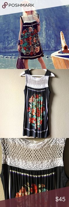 """Free People Black Fiesta dress This dress is beyond gorgeous!! Pretty crochet detail at the chest and upper back. Same floral design on the front & front. Colors: red, orange, green and cream with a purple line framing the flowers. One small blemish on the front left side (see picture). Measurements: pit to pit=18"""" and length is 35"""". Please ask any questions prior to purchasing. 😊 Free People Dresses"""