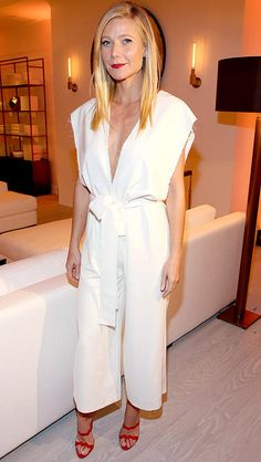 Gwyneth Paltrow in a white culotte jumpsuit and red heels
