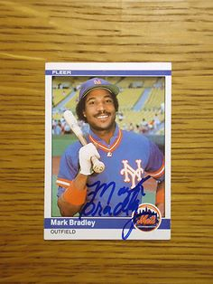 Mark Bradley: (1983 New York Mets) 1984 Fleer baseball card signed in blue sharpie. (From my All-Time Mets Roster collection.)