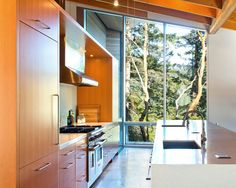 Kitchen with floor to ceiling windows.
