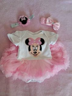 3mo Minnie mouse Onsie with ATTACHED skirt n matching Headband.  Will fit a Large Reborn Baby 21-22 in long.  Can choose to get with shoes or socks.  Headbands Measure 14 in.