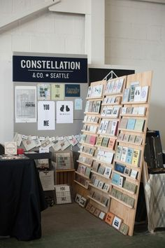 "Last weekend, we participated in the first ever Renegade Craft Fair in Seattle! The fair took place at beautiful Magnuson Park in Hangar 30. We packed up the C&Co. line of cards and prints, and set up shop in a 4' x 8' booth. My dad built us an awesome 7.5' tall back wall for displaying art prints and our hand painted logo sign. He also added ""kick stands"" to our card racks so they could stand alone. The booth was a tight squeeze, but I'm so happy with how it turned out! The fair had ..."