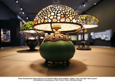 "artwork: Photo showing three lamps made by Louis Comfort Tiffany at the exhibition ""Tiffany: Color and Light"" which opened at the Musée du Luxembourg in Paris, France. Photo: EFE/Lucas Dolega"