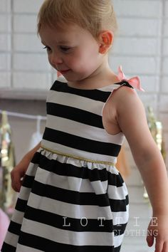 This stunning black and white stripe dress with a hint of pink is the most perfect dress for a special occasion - party, birthday or just a night out for dinner! With a Breakfast at Tiffanys feel, your little one will be the classiest dress little lady around. For each one of our garments a design is first drawn by us and a pattern is drafted and tested again by us at Lottie Clothing here in Sydney. Following this, each garment is hand made to order especially for you using quality…