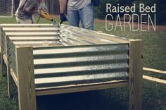 DIY Raised Garden Beds • Ideas & Tutorials! • A unique raised bed from tin roofing!