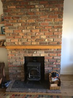 Reclaimed brick feature fireplace with Kilkenny limestone hearth ...