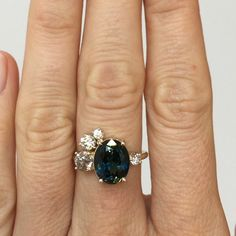 Big, I absolutely would LOVE an emerald or green stone that matches your eyes. I want a ring as unique as our love. Mociun Custom blue green sapphire and old mine cut white diamond stone cluster ring. Set in 14k yellow gold. https://instagram.com/p/8OUCmWIUEf/?taken-by=mociun