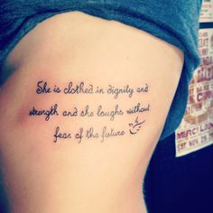 Rib tattoo. She is clothed in dignity and strength and she laughs without fear of the future. Proverbs 31:25