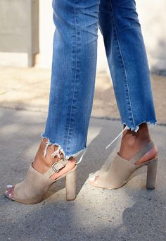 Get a jump start on spring with this raw-hem jeans and neutral suede sandals mix.