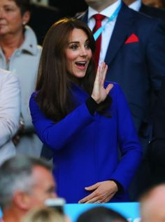 Kate waves to somebody in the crowd before England's game against Fiji