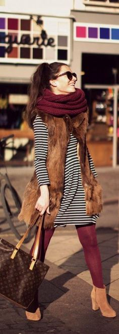 fur vest + stripe dress + burgundy details