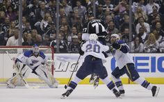 Los Angeles Kings' Jeff Carter(77) jumps to get the puck as St. Louis Blues' Alexander Steen (20), of Russia, and goalie Brian Elliott, background right, look on during the first period in Game 3 of a first-round NHL hockey Stanley Cup playoff series in Los Angeles, Saturday, May 4, 2013. (AP Photo/Jae C. Hong)