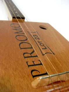 The Perdomo Lot 23  3 String Cigar Box Guitar built with a Perdomo Lot 23 Connecticut Churchill cigar box - Walnut Fretboard and Heel with Maple Neck and Bridge