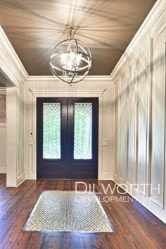 Entryway with beautiful light fixture