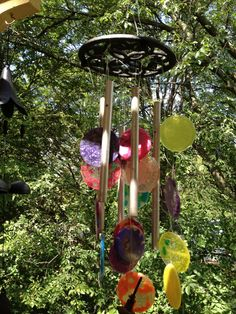 Upcycled wind chimes made with old tubes, a two dollar trivet and pony bead clackers.