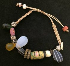 Quiero compartir lo último que he añadido a mi tienda de #etsy: Rework Macrame Bracelet http://etsy.me/2BS5vvi  Joya única realizada con antiguas piezas #joyeria #brazalete #tradebeads #perlaynacar #bohemianbeads #joyaunica #boho #perlasafricanas #muranoglass