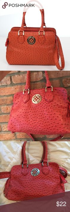 London Fog Ostrich Handbag London Fog pinkish/Orange handbag. 3 zipper pockets. Great condition. First picture is offline of the exact same bag except it's orange, the one I am selling is more pink. London Fog Bags