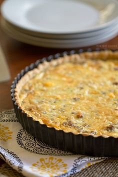Sausage Egg and Cheese Quiche Tart from This Gal Cooks. #breakfast #casseroles #eggs