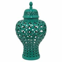 "Create an eye-catching focal point on your mantel or coffee table with this exotic jar, featuring an openwork design and dark mint hue.  Product: Apothecary jarConstruction Material: Porcelain and ceramicColor: Dark mintDimensions: 15.75"" H x 8.25"" Diameter"