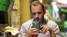 man at cafe taking photo of food - Google Search