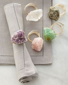 Handcrafted napkin rings sold individually. Made of natural stones. Available in Purple (amethyst), Pink (rose quartz), Green (calcite), Graphite (tumbled pyrite), or White/Clear (rock crystal). Due t