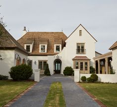 White exterior with cedar shingles roof