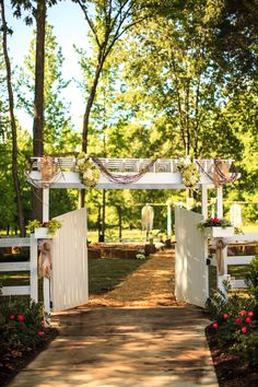 white gate at entrance to a wedding ceremony, with hay laid on the ground! loooove it. this wedding was so full of BEAUTIFUL details {click the link}!