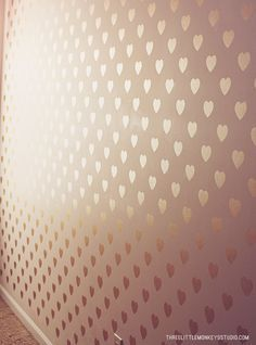SO chic! Metallic gold stenciled heart accent wall - HomeMade Home Series | Wall Stenciling for Beginners