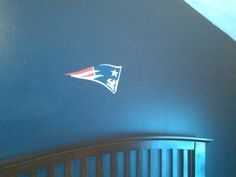 This is just the start of my son's wall decorations in his bedroom.  This is the NE Patriots logo.  I cut this by hand with vinyl.  This is my second project with vinyl and it has a lot of layers.  I need to keep practicing the technique as it's a little tricky, especially with so many layers.  I also cut out the words and will be adding them next.