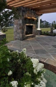 nice patio and outdoor fireplace one day this is what ill have to relax on.