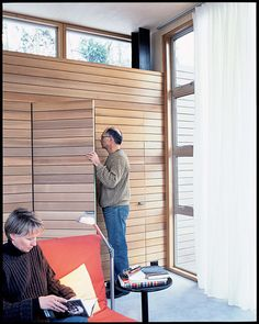 """In their search to find an alternative to drywall, the couple discovered this lightweight, nontoxic Italian poplar siding at a local lumberyard. """"The Seattle Opera uses it for stage sets, and the lumberyard carries a large amount of the product to outfit Wood Slat Wall, Wood Slats, Small Space Living, Small Spaces, Alternatives To Drywall, Invisible Doors, Hidden Closet, Washington Houses, Wooden Room"""