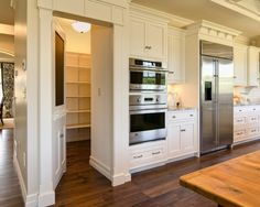Could be an option for pantry wall being reconfigured.  Close off office hallway and discover more pantry space or pocket or built ins.